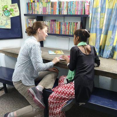Freya Reading to local pupil.jpg